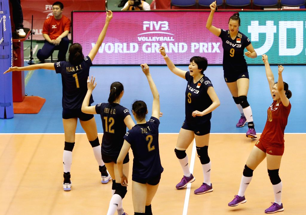 Chinese players celebrate after winning the game against Italy during the preliminary round match of the 2015 FIVB Volleyball World Grand Prix in Saitama, Japan, ...