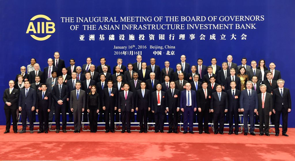 Chinese Premier Li Keqiang poses for group photos with representatives from founding member countries before the founding conference of the Asian Infrastructure ...
