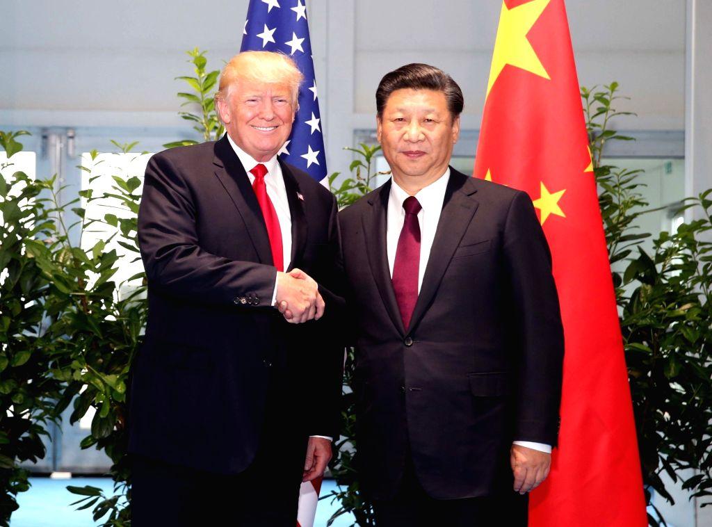 Chinese President Xi Jinping and U.S. President Donald Trump. (Xinhua/Yao Dawei/Jin Yu/IANS)