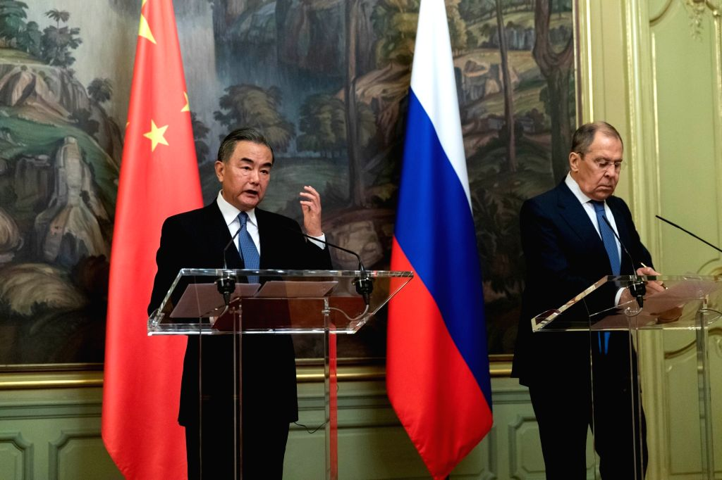 Chinese State Councilor and Foreign Minister Wang Yi (L) and Russian Foreign Minister Sergei Lavrov meet the press after their talks in Moscow, Russia, on Sept. 11, ... - Wang Y