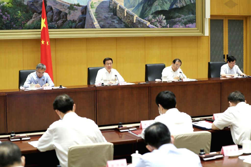 Chinese Vice Premier Han Zheng, also a member of the Standing Committee of the Political Bureau of the Communist Party of China Central Committee, attends a ...