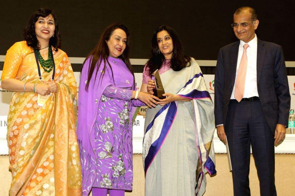 Chintan Director Bharati Chaturvedi receives the FLO Icon Award during 34th Annual Session of FICCI Ladies Organisation (FLO) at Vigyan Bhavan in New Delhi on April 5, 2018.