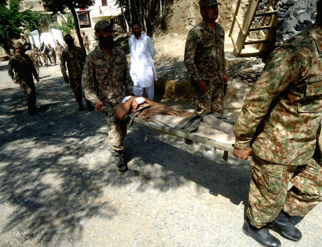 CHITRAL, July 3, 2016 - Photo released by Pakistan's Inter Service Public Relations (ISPR) on July 3, 2016 shows Pakistani soldiers transfer an injured survivor in Chitral, northwest Pakistan. At ...