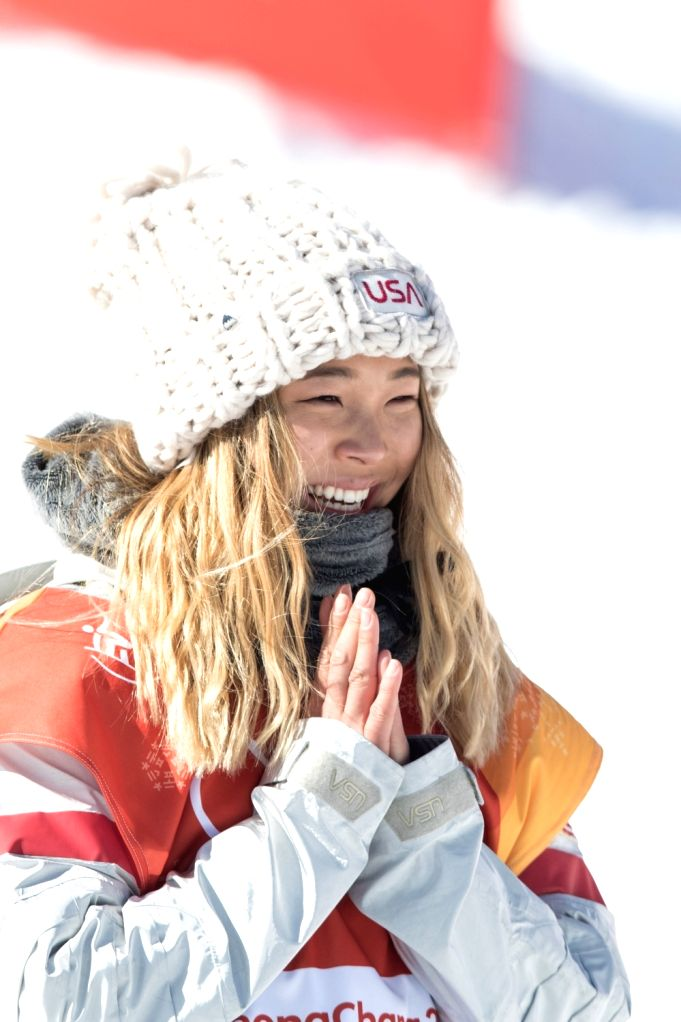 :Chloe Kim of the U.S. celebrates after ladies' halfpipe finals of snowboard at the 2018 PyeongChang Winter Olympic Games at Phoenix Snow Park in ...