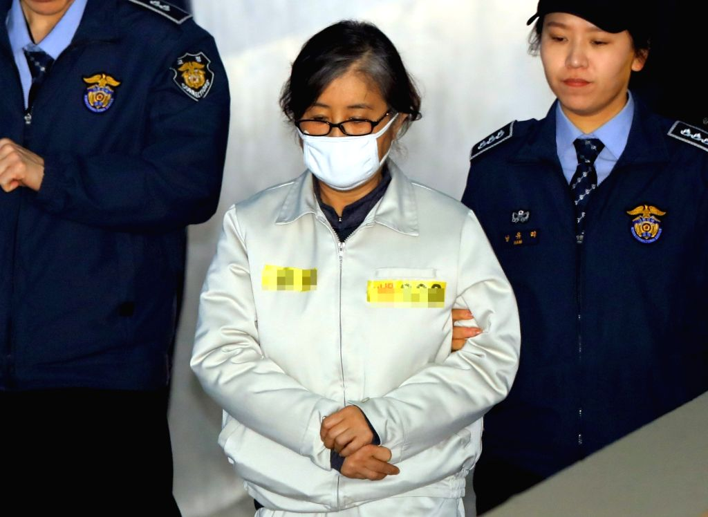Choi Soon-sil, a key figure in the corruption scandal that led to parliament's impeachment of the president, arrives at the Seoul Central District Court for trial on March 10, 2017. The ...