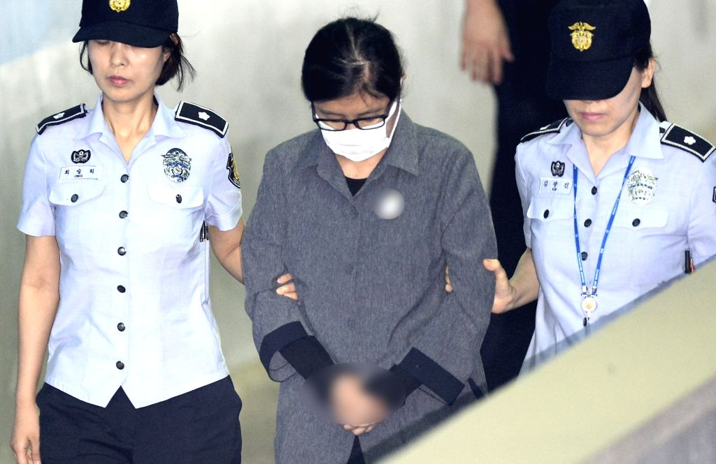 Choi Soon-sil(C) arrives at the Seoul Central District Court, South Korea, on June 23, 2017. Choi Soon-sil, a close confidante of impeached South Korean President Park Geun-hye, on Friday got ...