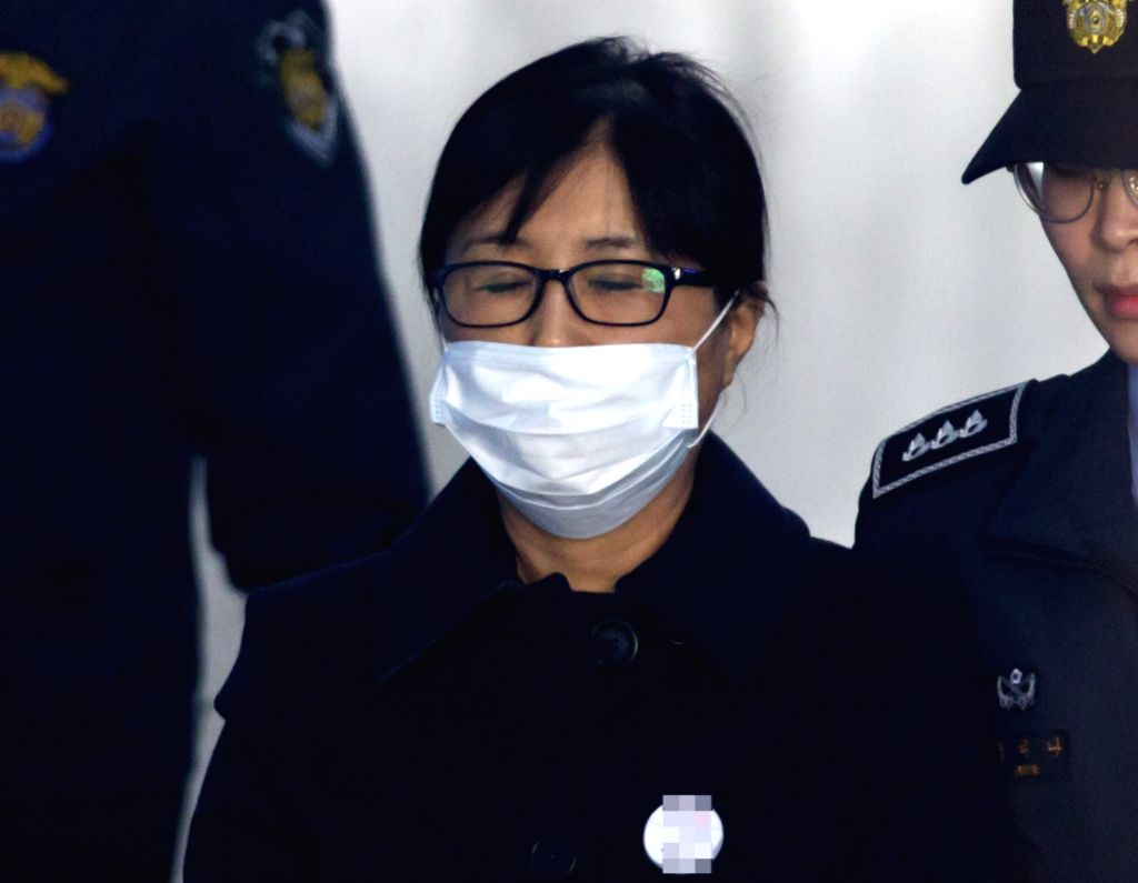 Choi Soon-sil heads to a Seoul courthouse on Feb. 13, 2018, for sentencing in a corruption case linked to ousted former President Park Geun-hye. Choi, a close personal friend of Park, was ...