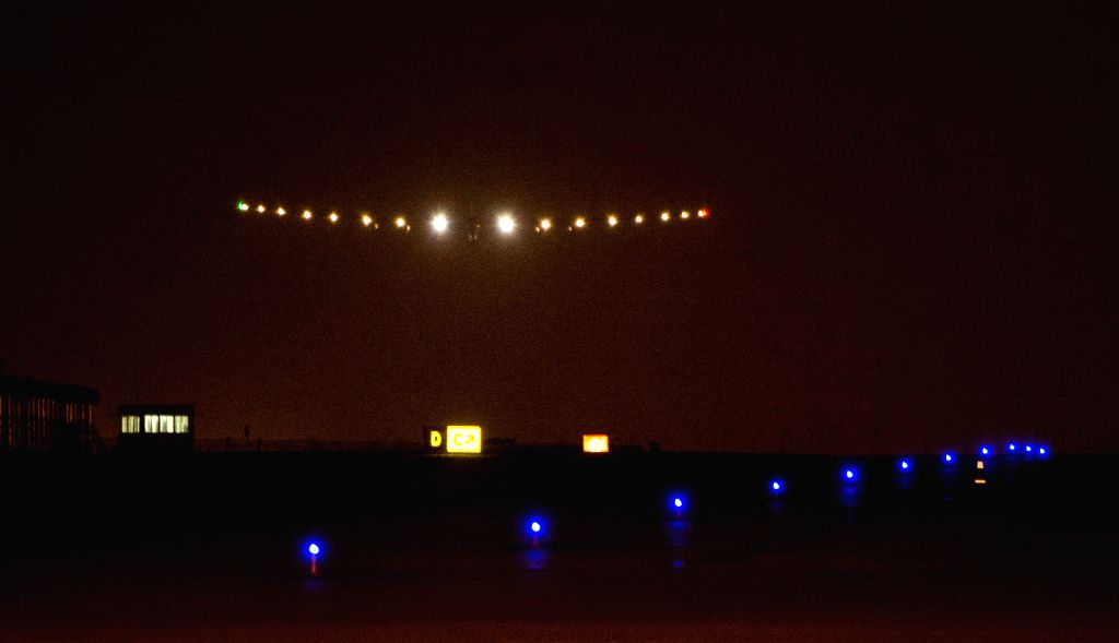 The Solar Impulse 2, the world's biggest solar-powered plane, lands at Chongqing Jiangbei International Airport in Chongqing, southwest China, March 31, 2015.  ...