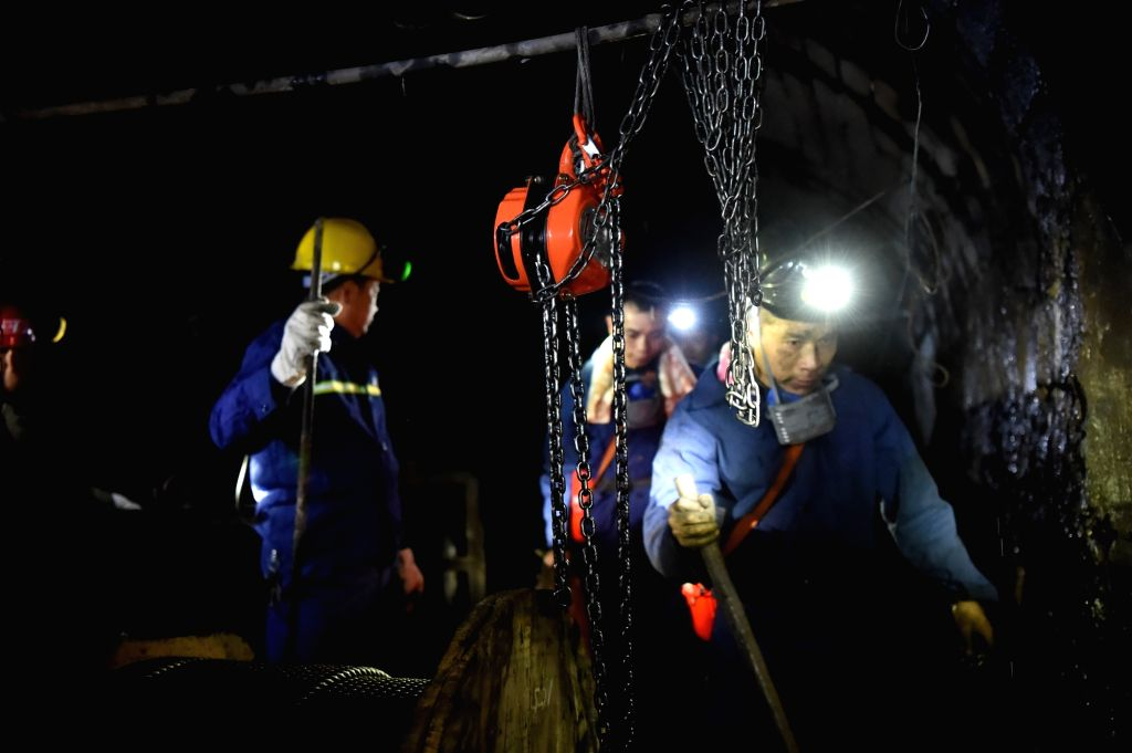 CHONGQING, Nov. 1, 2016 - Rescuers work at Jinshangou Coal Mine in Yongchuan District of Chongqing, southwest China, Oct. 31, 2016. Rescuers are working around the clock to search for 20 miners who ...