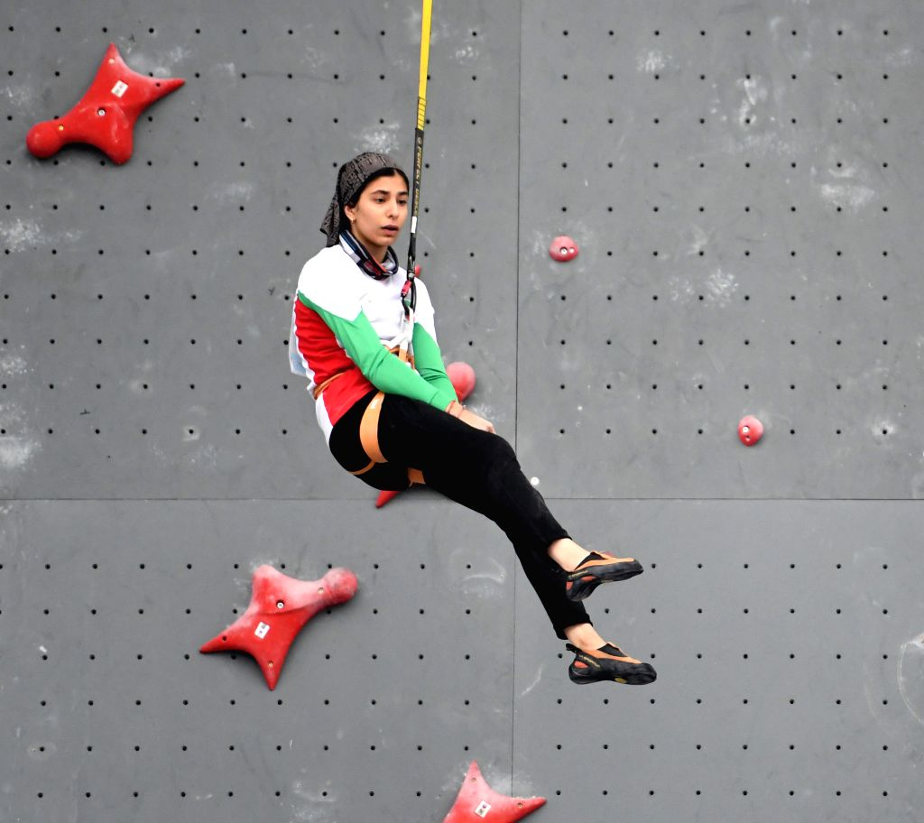CHONGQING, Nov. 16, 2019 - Iran's Mahya Darabian reacts after winning the female youth A combined speed overall final against South Korea's Choi Nawoo at the 2019 Asian Combined Youth Championships ...