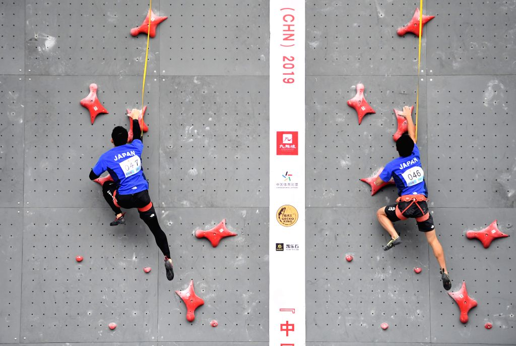 CHONGQING, Nov. 16, 2019 - Japan's Takeda Hajime (L) and Nukui Ryoei compete during the male youth A combined speed overall final at the 2019 Asian Combined Youth Championships in Chongqing, ...