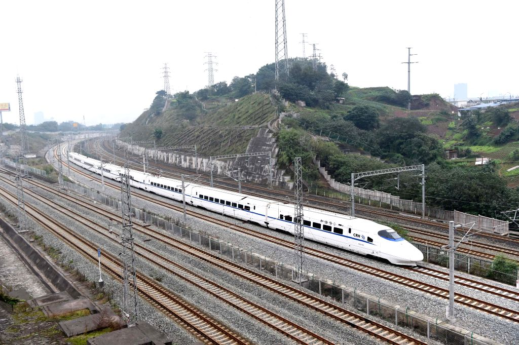 CHONGQING, Nov. 28, 2016 - A train runs on Chongqing-Wanzhou high-speed railway, southwest China, Nov. 28, 2016. The first high-speed railway running through China's Three Gorges reservoir region ...
