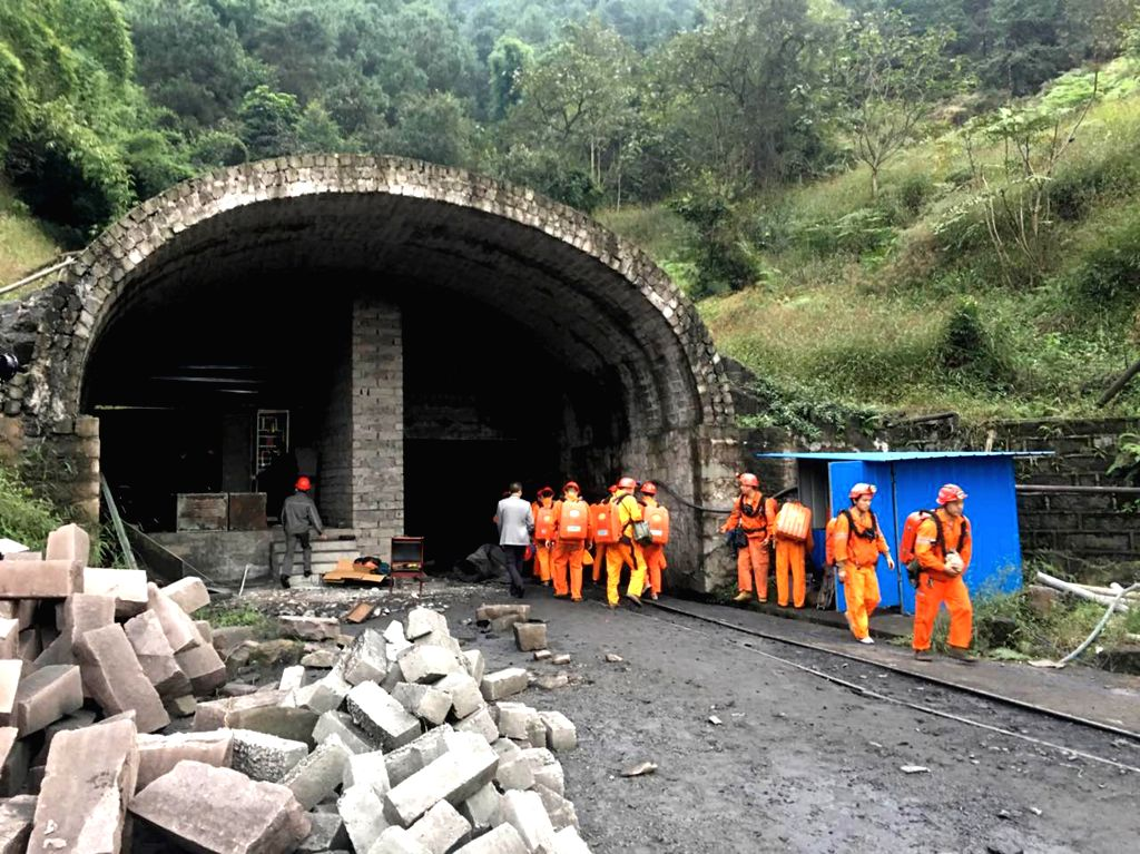 CHONGQING, Oct. 31, 2016 - Rescuers work at Jinshangou Coal Mine in Laisu Town of Yongchuan District in Chongqing, southwest China, Oct. 31, 2016. 33 miners were trapped underground after a gas ...