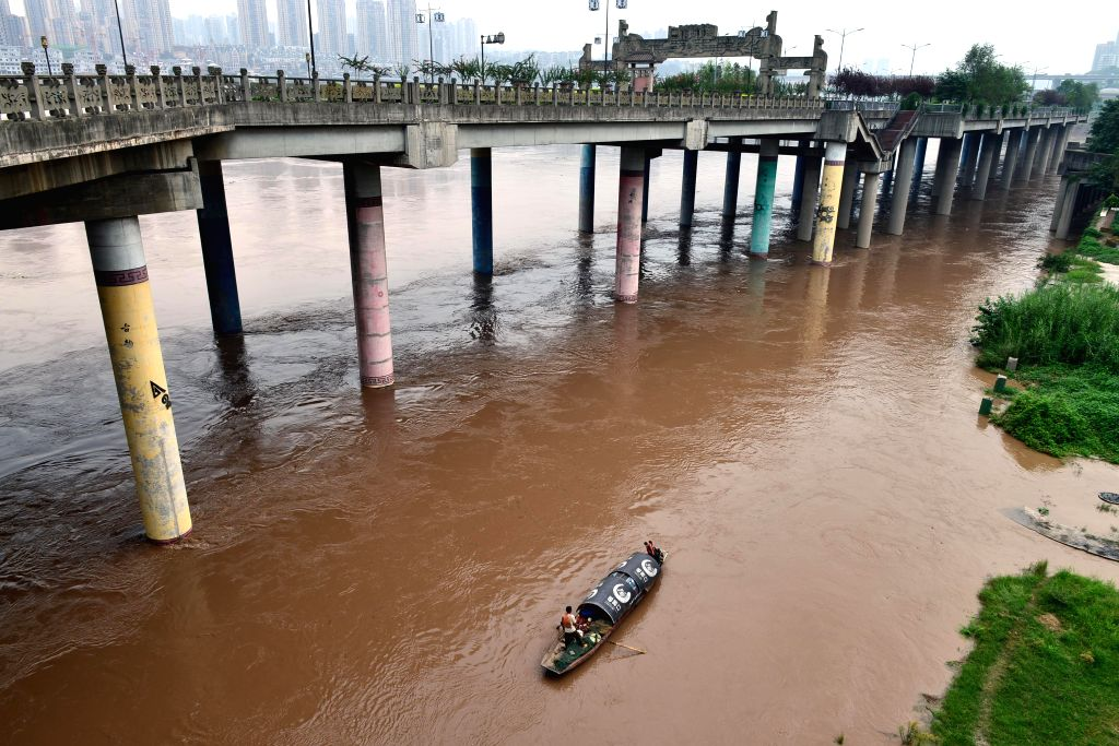 A boat sails on the Jialing River whose water level has risen in Ciqikou ancient town in the Shapingba District of Chongqing, southwest China, Sept. 12, 2014. ...