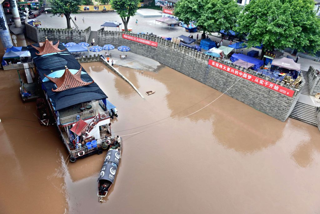 A parking lot is flooded by the rising Jialing River water in Ciqikou ancient town in the Shapingba District of Chongqing, southwest China, Sept. 12, 2014. ...