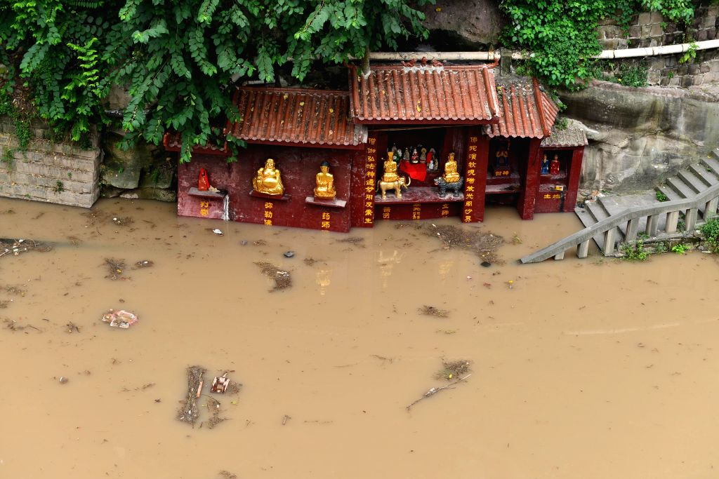 The Guanyin Temple is flooded by the rising Jialing River water in Ciqikou ancient town in the Shapingba District of Chongqing, southwest China, Sept. 12, 2014. .