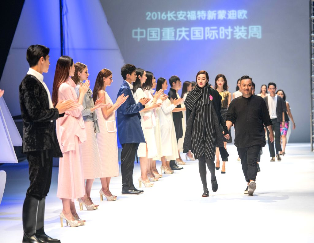 CHONGQING, Sept. 14, 2016 - Designers and models attend the Chongqing Fashion Week in Chongqing, southwest China, Sept. 13, 2016. The six-day fashion week started on Tuesday.