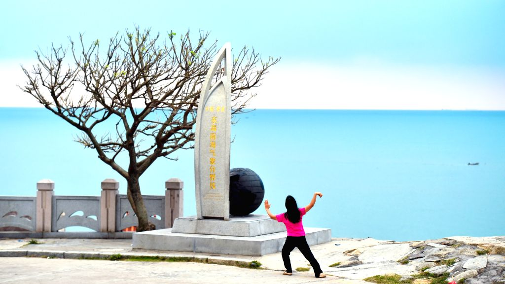 CHONGWU, Oct. 4, 2016 - A citizen takes exercise outside of Chongwu ancient town in Quanzhou, southeast China's Fujian Province, Oct. 4, 2016. Chongwu ancient town, a stone town, was one of the over ...