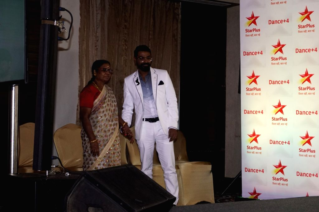 Choreographer-film director Remo D'Souza along with his mother Madhaviyamma Nair during a media interaction to promote his upcoming reality television show Dance Plus Season 4 in Mumbai on ... - Remo D