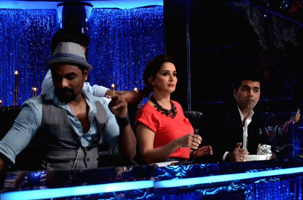 Choreographer Remo D`Souza, actor Madhuri Dixit and filmmaker Karan Johar on the sets of Jhalak Dikhhla Jaa 7 during the promotion of film Bobby Jasoos in Mumbai, on July 1, 2014. - Madhuri Dixit and Karan Johar