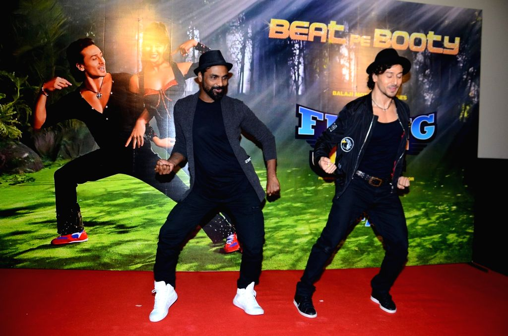 Choreographer Remo D'Souza and actor Tiger Shroff during the launch song, Beat pe Botty, from film A Flying Jatt, in Mumbai, on Aug 5, 2016. - Tiger Shroff