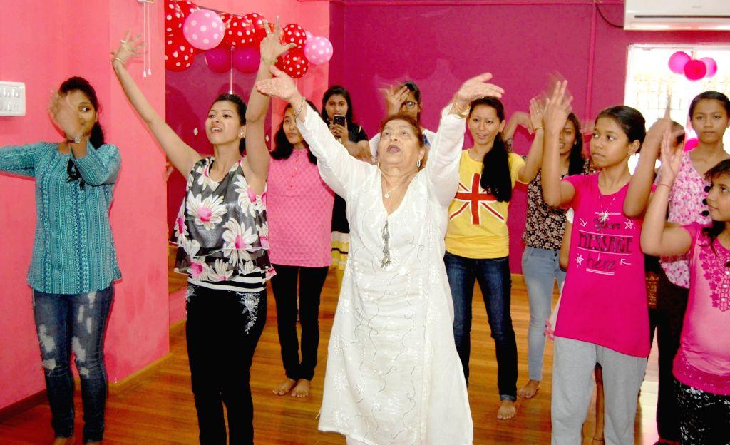Choreographer Saroj Khan gives dance tips to the students of Khan Dance Academy in Guwahati on April 18, 2016. - Saroj Khan