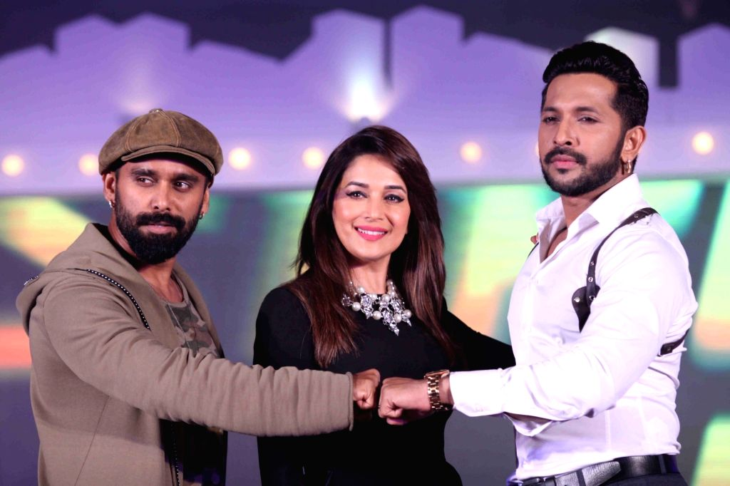 Choreographers Bosco Martins (L), Terence Lewis (R) and actor Madhuri Dixit during the announcement of &TV dance show So You Think You Can Dance in Mumbai on April 19, 2016. - Madhuri Dixit