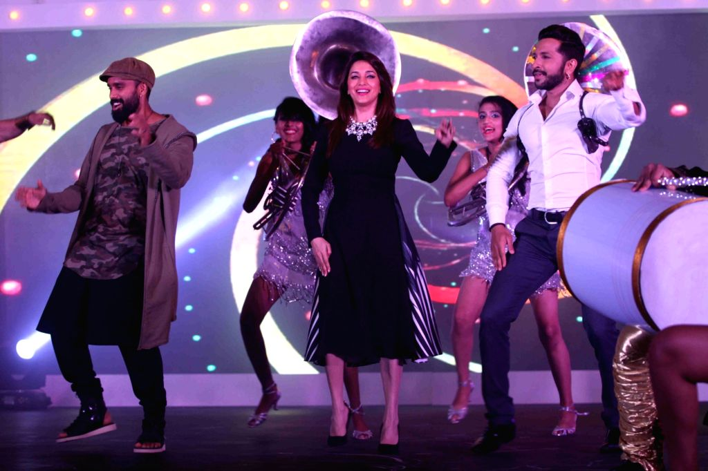 Choreographers Bosco Martins, Terence Lewis and actress Madhuri Dixit during the announcement of &TV dance show So You Think You Can Dance in Mumbai on April 19, 2016. - Madhuri Dixit
