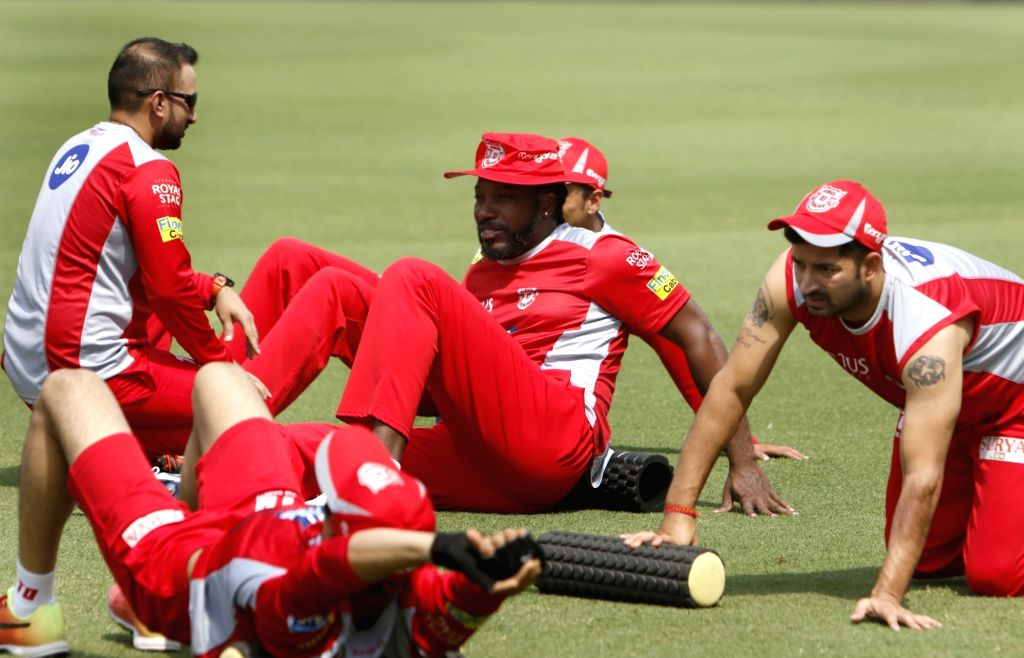 Chris Gayle (C) of Kings XI Punjab, during a practice session in Mohali on April 7, 2018.