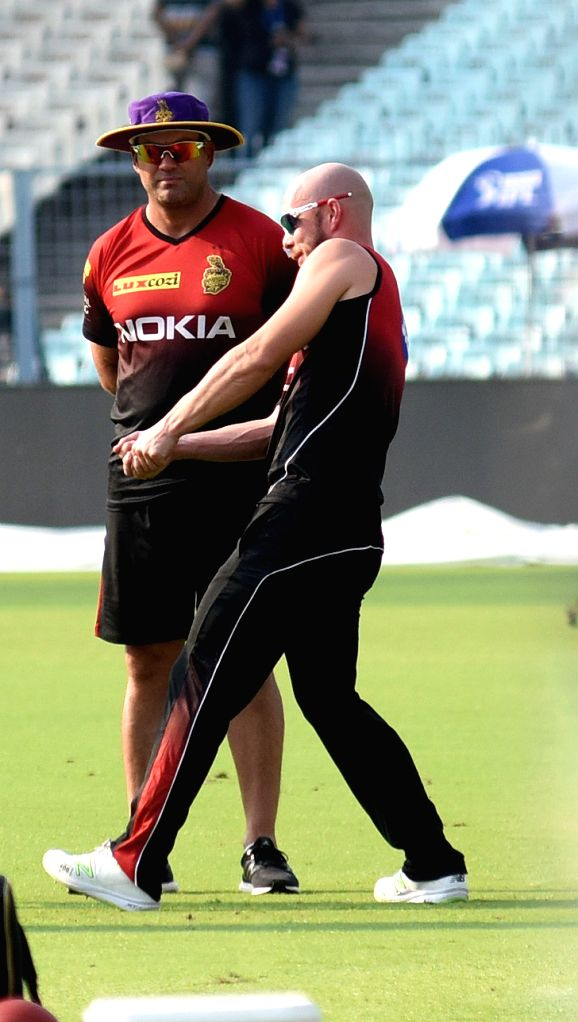 Chris Lynn and Jacques Kallis (coach) of Kolkata Knight Riders (KKR) during a practice session at Eden Gardens in Kolkata, on April 13, 2018.