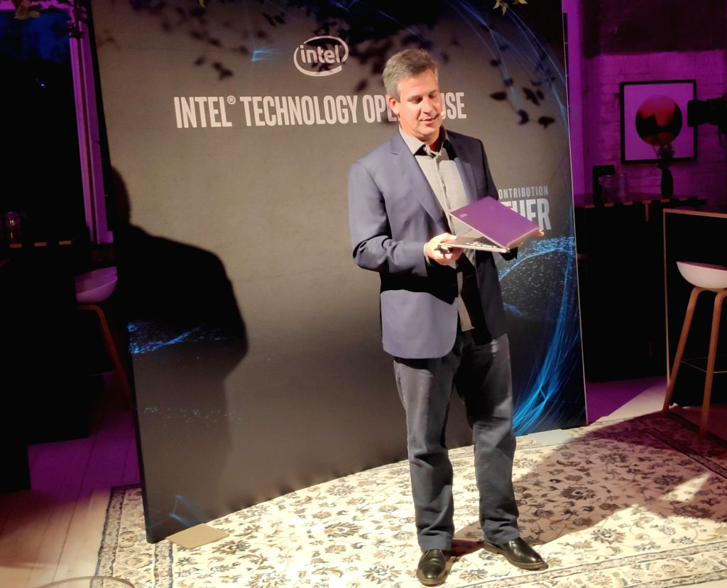 Chris Walker, Intel Corporate Vice President and General Manager, Mobile Content Platforms in the Client Computing Group, showcasing the Lenovo YOGA S940 powered by 10th Gen Intel Core Processor in ...