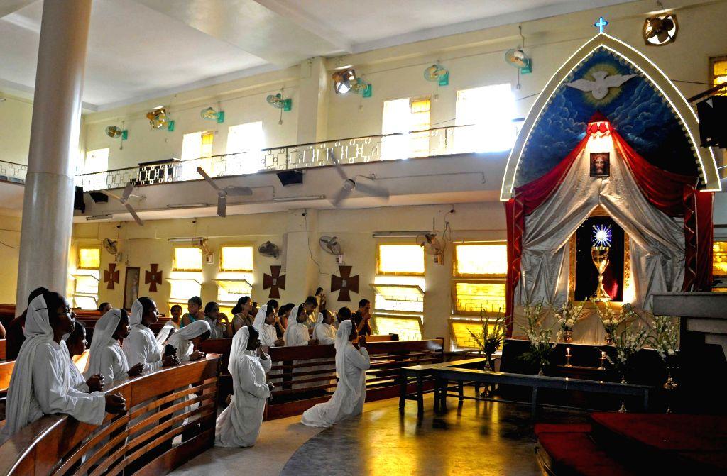 Christian nuns offer prayers at a Kolkata Church of Good Friday in Kolkata, on April 3, 2015.