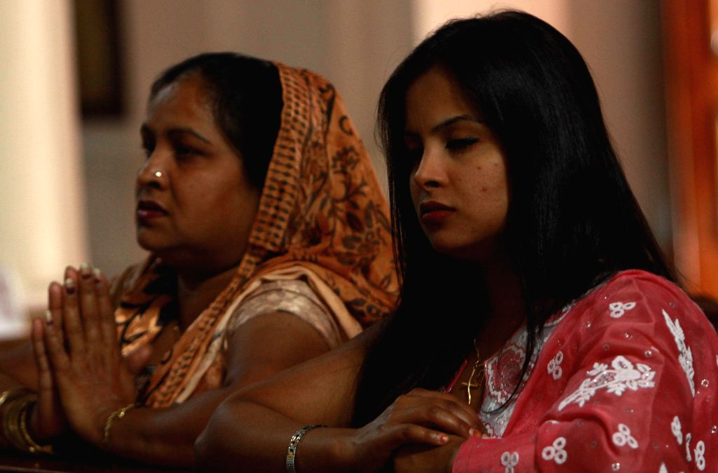 Christians offer prayers in a church on Easter Sunday in New Delhi on April 20, 2014.