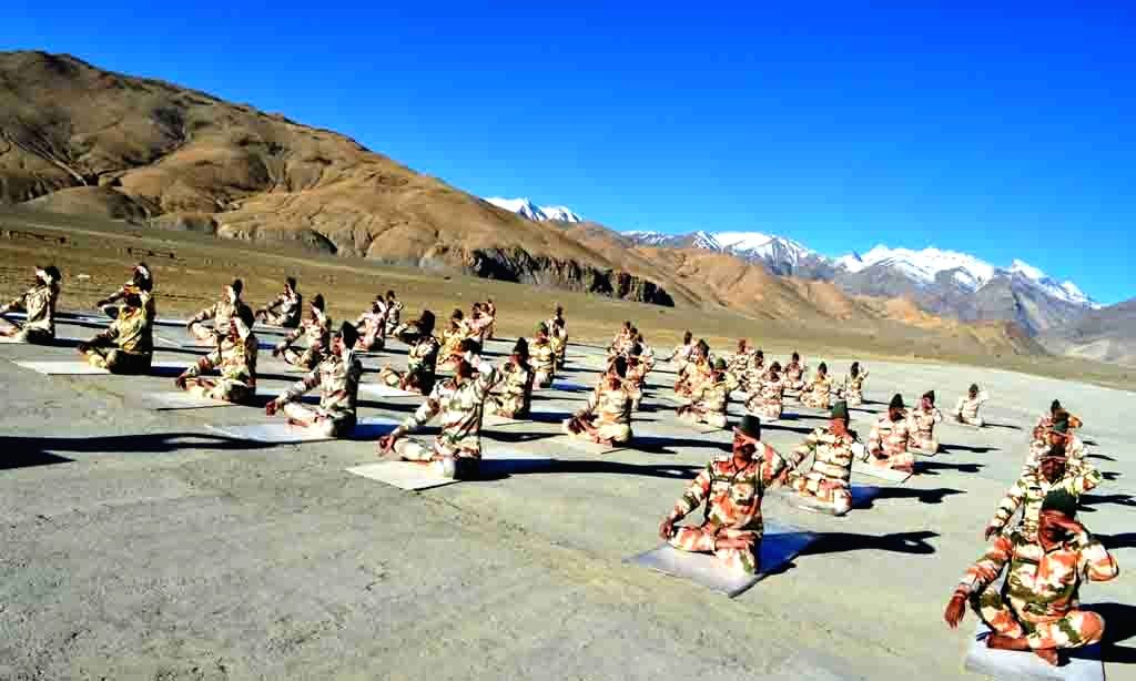 Chumar: The ITBP personnel practice yoga near Chumar 15K Ft in Laddakh on the occasion of the 5th International Day of Yoga 2019 on June 21, 2019. (Photo: IANS/PIB)