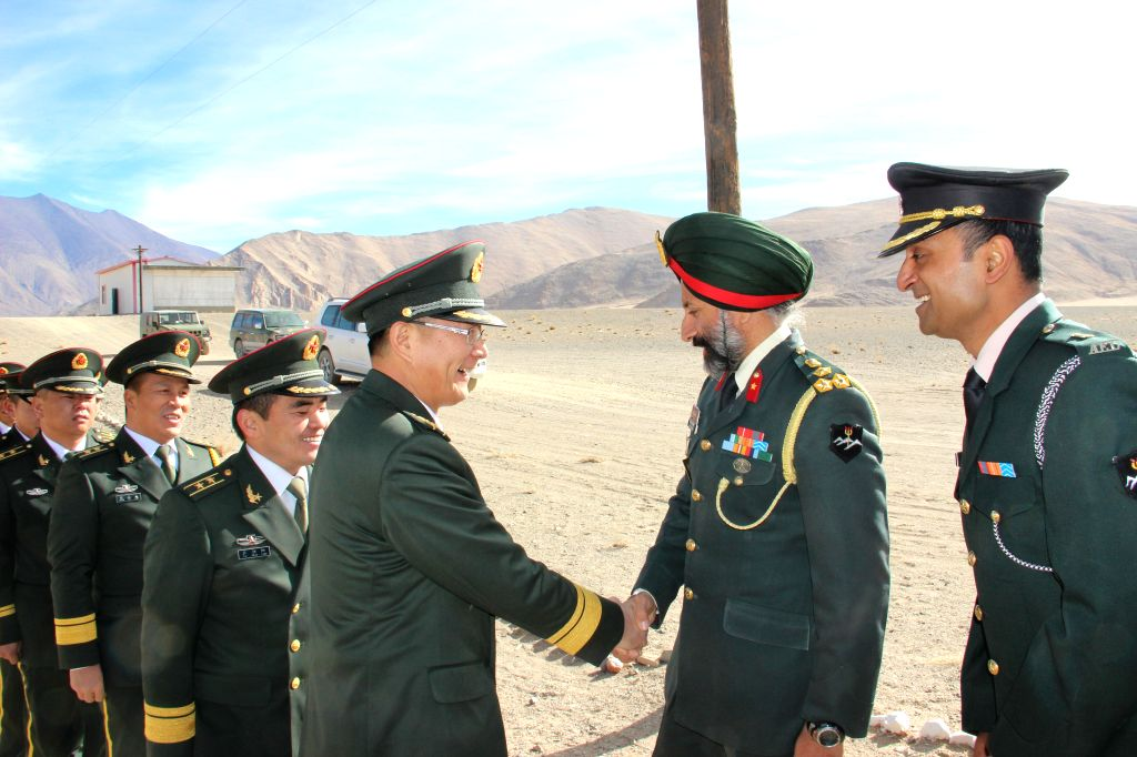 Indian and Chinese military personnel meet during a ceremonial meeting on Indian Army's Flag Day on the Indian side of the Line of Actual Control in the Chushul sector in Ladakh of Jammu and