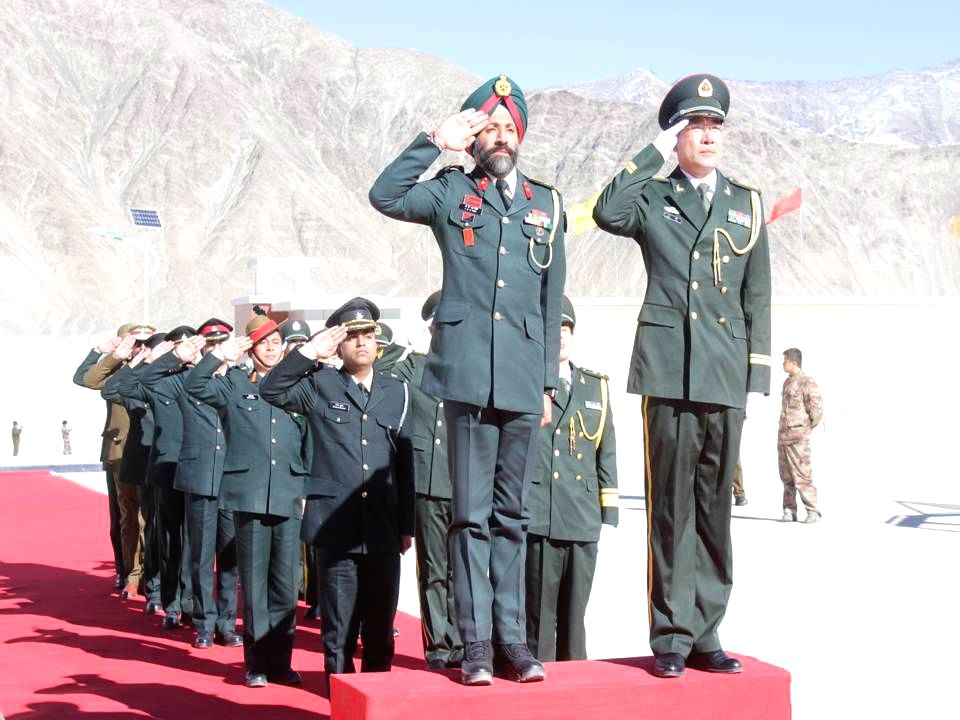 Indian Army personnel and PLA personnel from China during a ceremonial meeting organised on `New Year` at the Line of Actual Control in the Chushul sector, Ladakh, Jammu and Kashmir on Jan ..