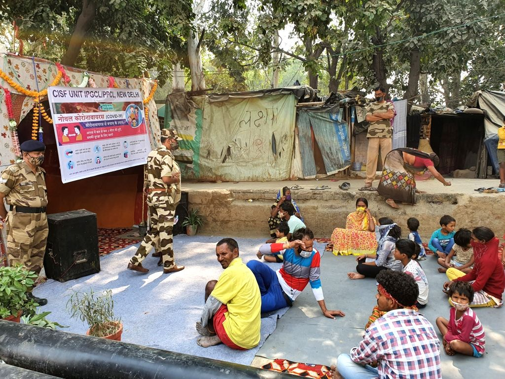 CISF soldiers spread awareness about coronavirus in rural settlements, distribute masks among children