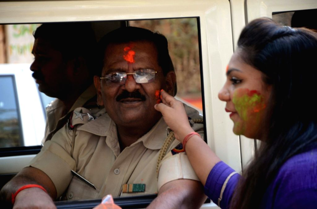 Citizens celebrate Holi with police officers in Mumbai on March 13, 2017.