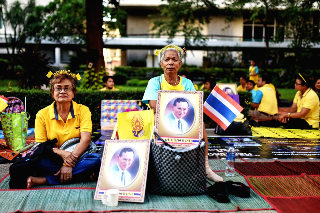 Citizens gather at an open ground to observe the King Bhumibol Adulyadej's 88th birthday inside the Siriraj Hospital, where the King currently lives, in Bangkok, ...