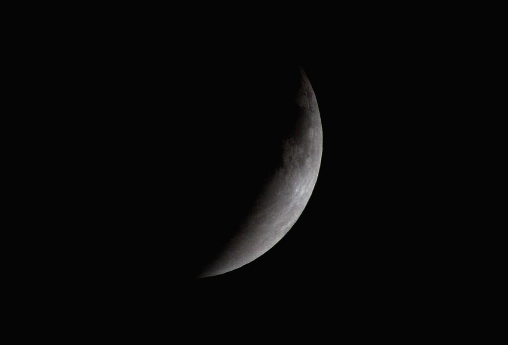 The Moon is seen during an eclipse, in the sky above Mexico City, capital of Mexico, early April 15, 2014. The eclipse made the Moon look reddish in many .