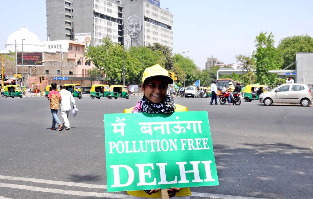 Civil Defence volunteers stand on Delhi streets with placards urging people to follow odd-even traffic formula  on April 15, 2016.