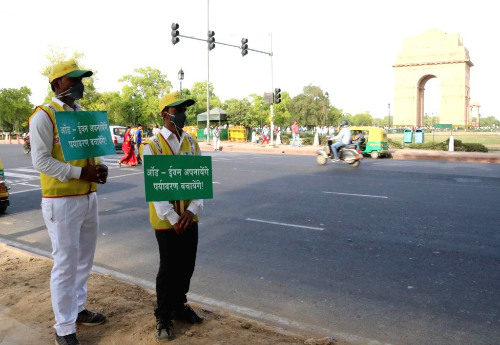 Civil Defence volunteers stand on Delhi streets with placards urging people to follow odd-even traffic formula on April 16, 2016.