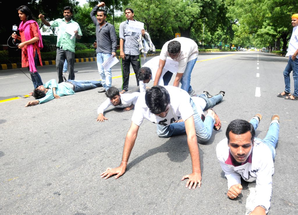 Civil service aspirants lay down on the road during a demonstration to press for scrapping of Civil Services Aptitude Test (CSAT) in New Delhi on Aug 7, 2014.