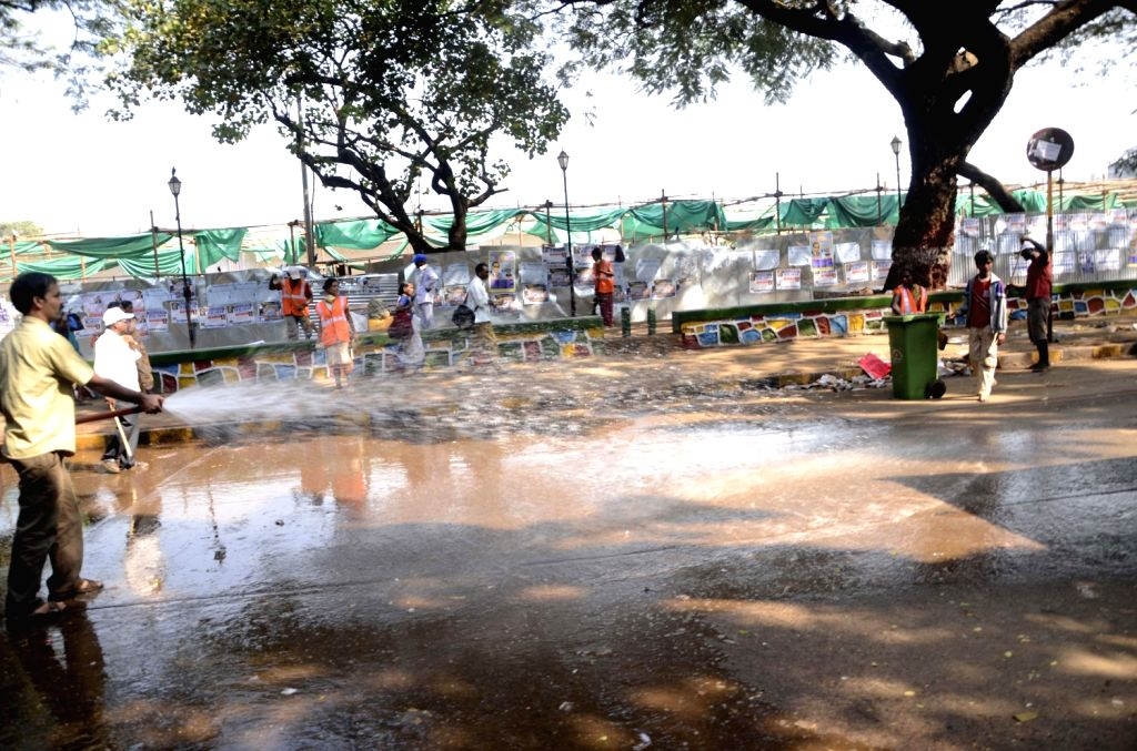 Civil workers clean up Shivaji Park in Dadar after the death anniversary of Dr. BR Ambedkar in Mumbai on Dec. 7, 2013.