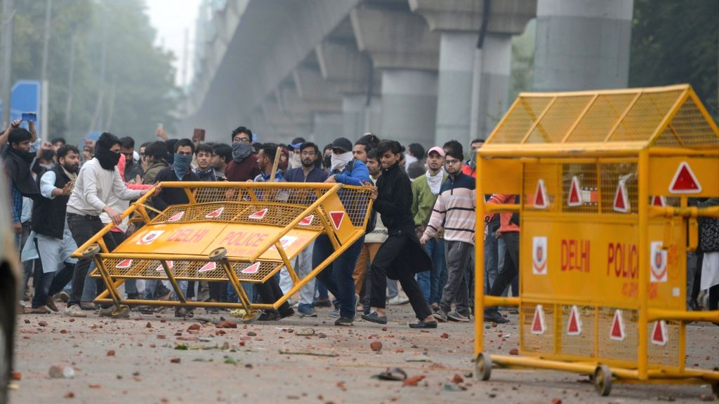 Clashes break out in New Delhi as Jamia Millia Islamia students pelted stones on security forces outside Jamia Millia Islamia after they take out a protest march to Parliament to oppose ...