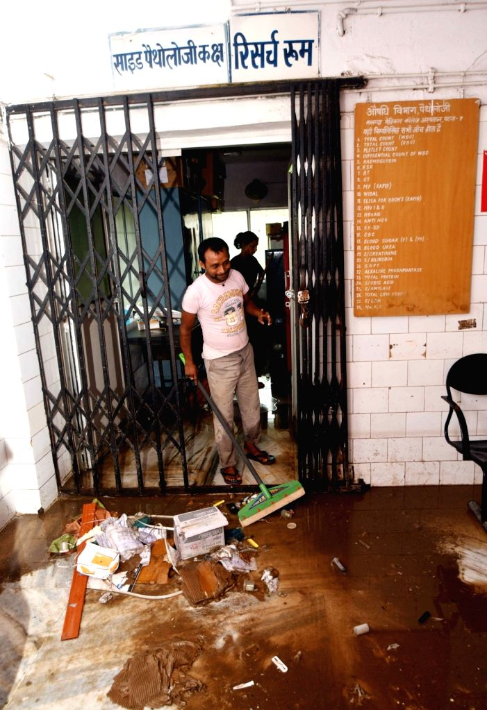 Cleaning drive underway after heavy rains left the Intensive Care Unit (ICU) of Nalanda Medical Hospital water-logged, in Patna on July 30, 2018.