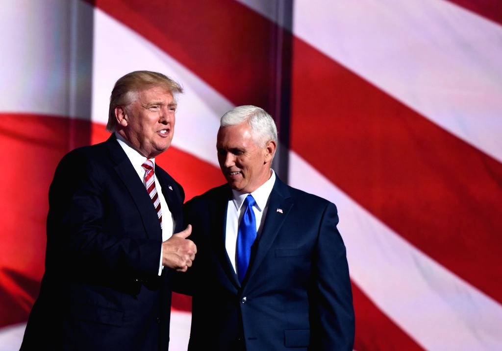 CLEVELAND, July 21, 2016 - Republican presidential nominee Donald Trump (L) and vice presidential nominee Mike Pence take the stage at the Republican National Convention in Cleveland, Ohio, the ...