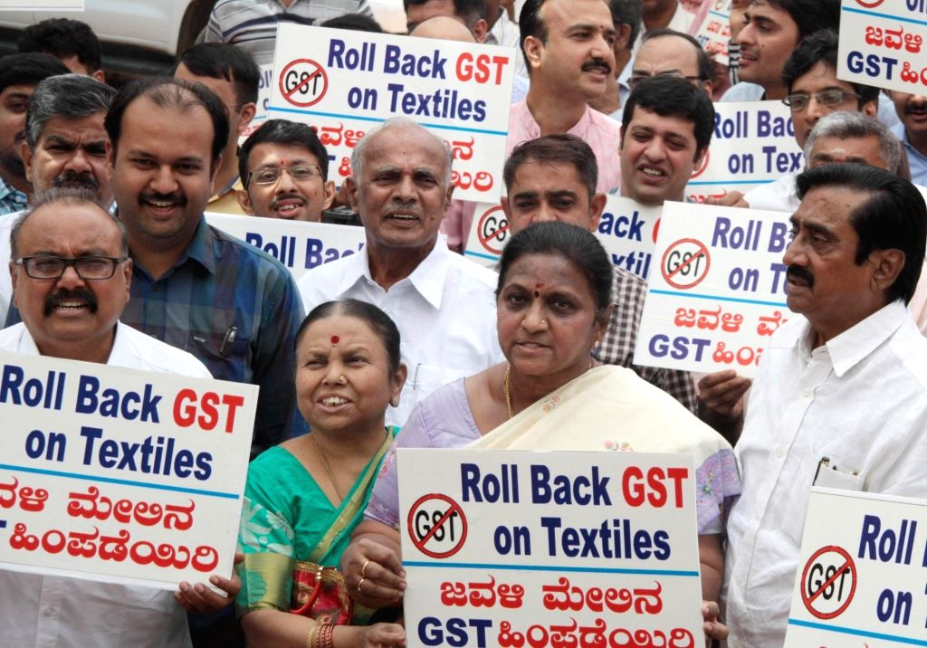 Cloth merchants stage a demonstration against GST in Bengaluru on June 30, 2017.