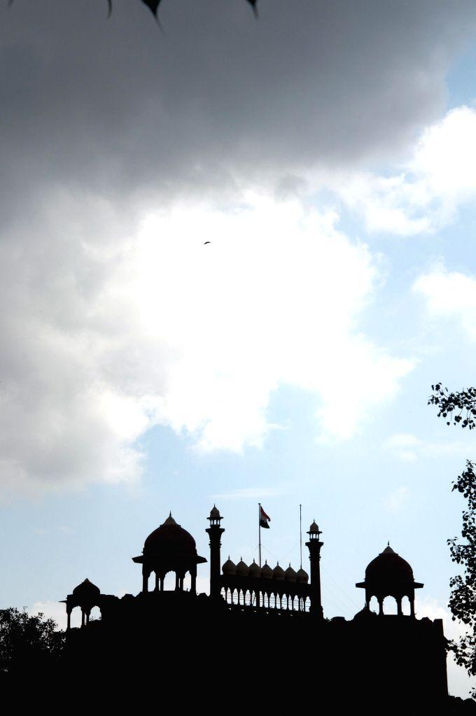 Cloudy sky over Delhi, light rain expected.