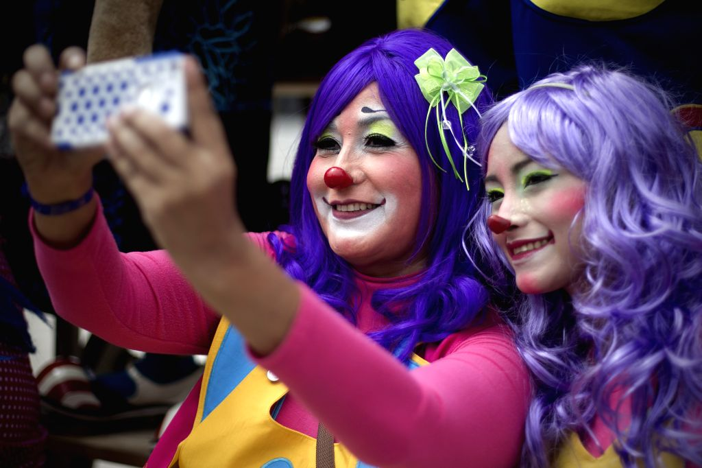 "Clowns take a ""selfie"" in the 20th International Clowns Convention in Mexico City, capital of Mexico, on Oct. 21, 2015. During the convention that is ..."